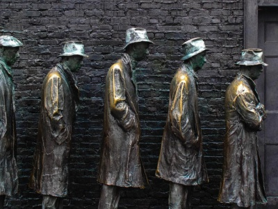 Statue of men waiting in a bread line during the Great Depression