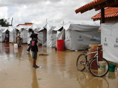 Residents mill around USAID temporary housing