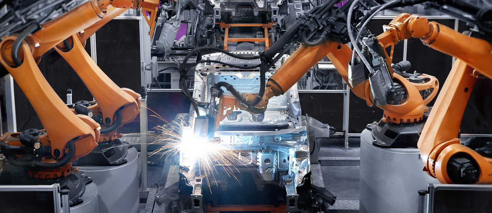 Robotic welders building a car on an automated assembly line